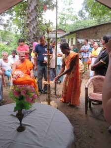 monk lighting the candle blessing the build sites.
