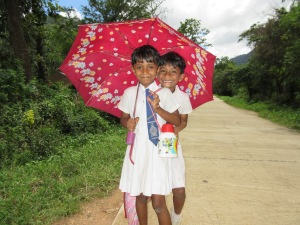 Two school girls returning home in the afternoon.